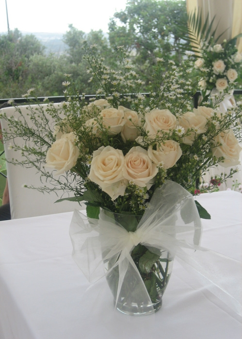 plain white roses with a hint of tiny daisies
