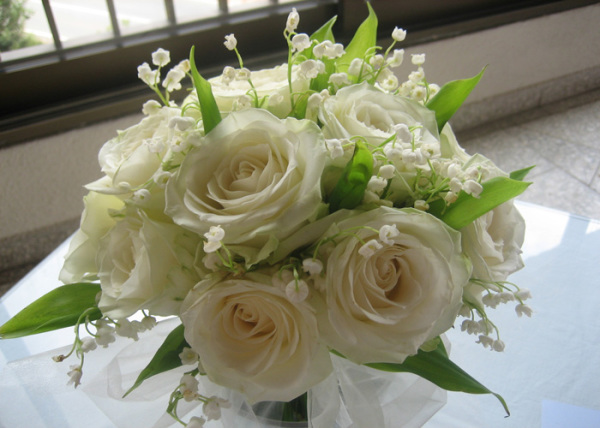 white rose with lily of the valley