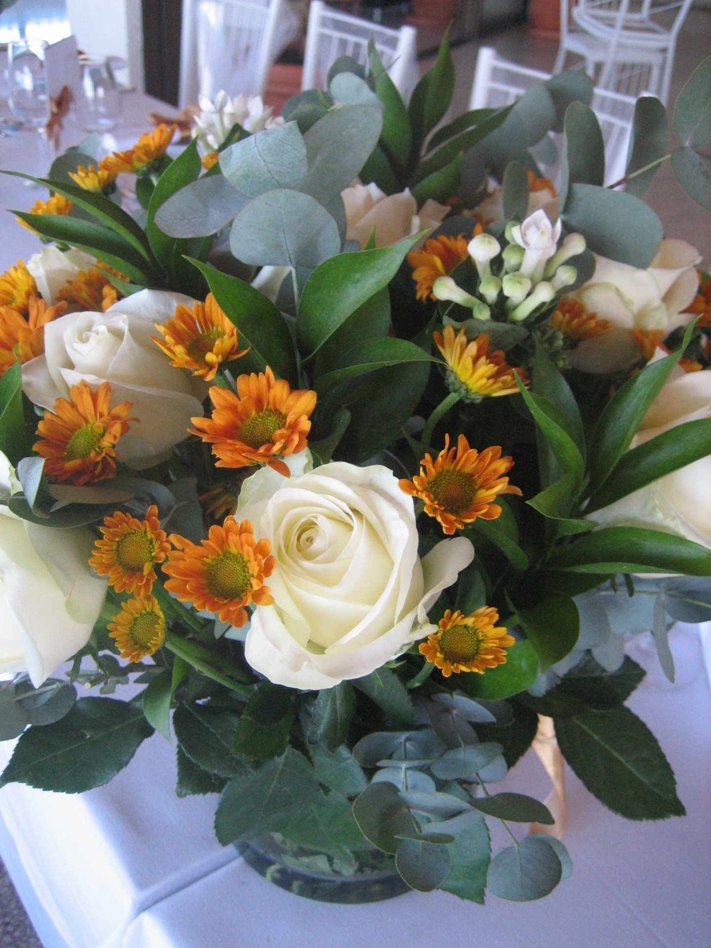 burnt orange chrysanemums, white carnations & roses
