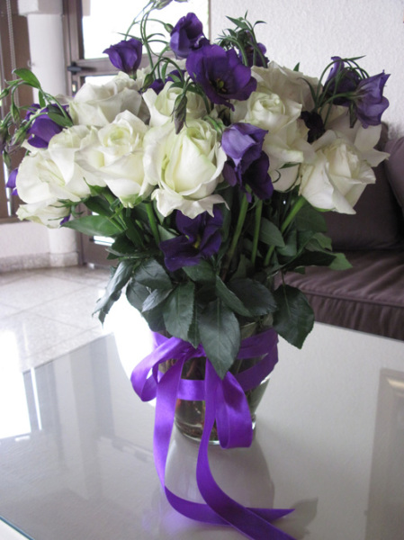 white roses and purple lysianthus