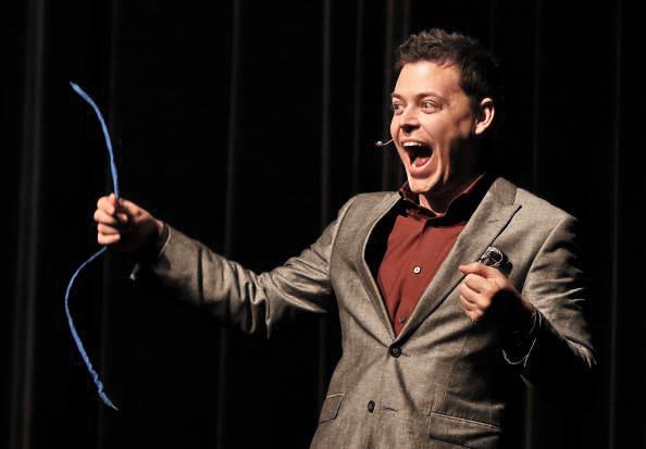 Winnipeg Magician Patrick Gregoire holding a blue shoelace