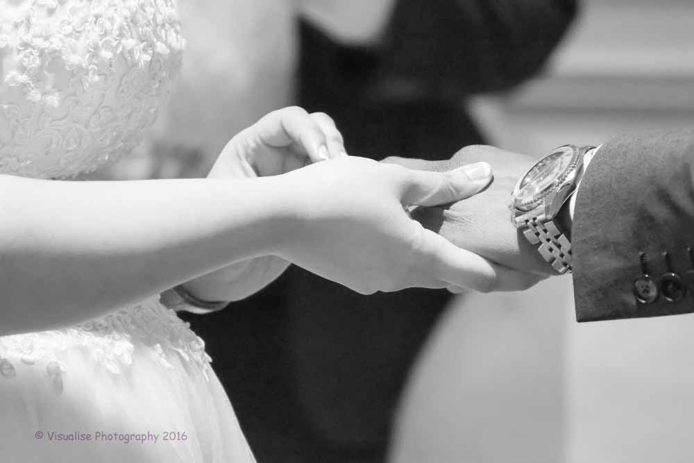 bride and groom exchanging rings in oxford wedding photographer