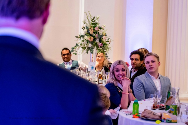 the wife of the best man watches proudly as he makes his speech at his brothers wedding