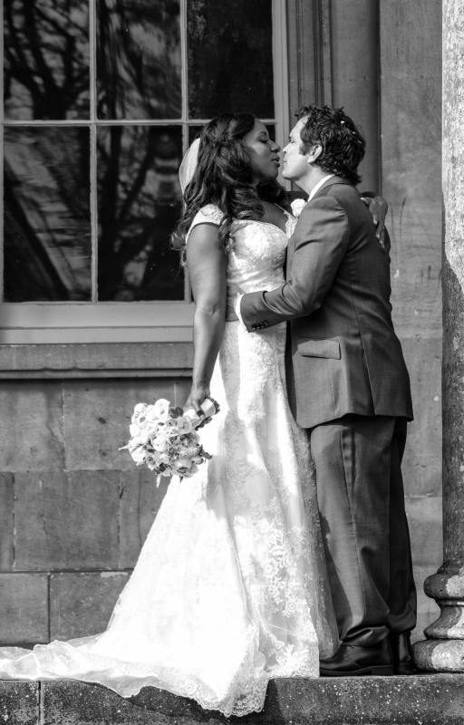 bride and groom kissing wedding photography in cheltenham uk