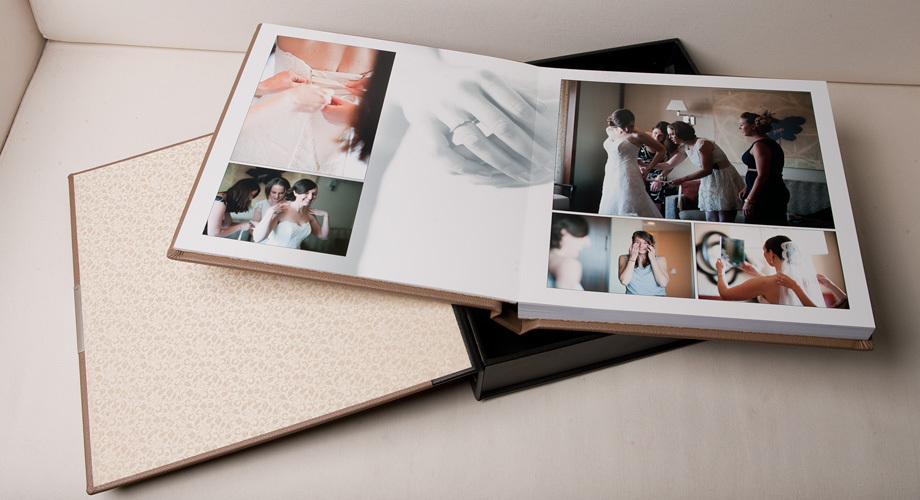 a bespoke wedding album in a box open on a page