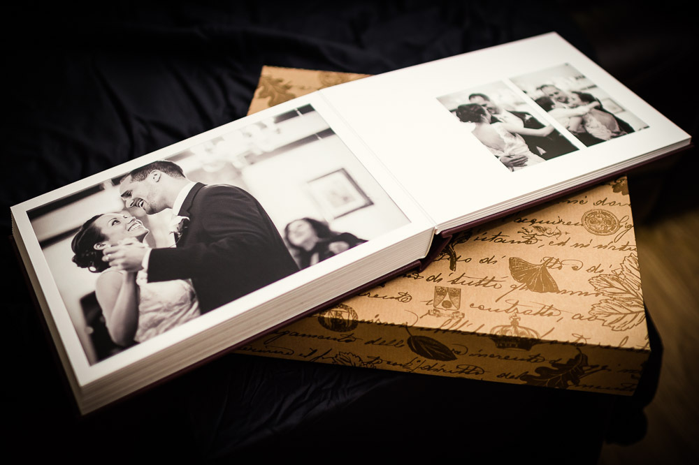 a handmade bespoke wedding album in lay flat and leather bound
