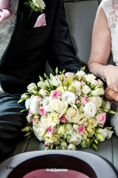 the brides bouquet between the bride and groom  London wedding photographer