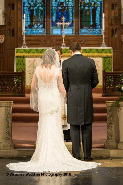 Bride and Groom at the Alter , St Marys Church Wimbledon.