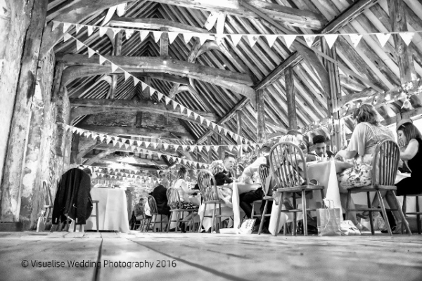 carterton wedding photographer wedding guest seated at the unicorn theatre abingdon