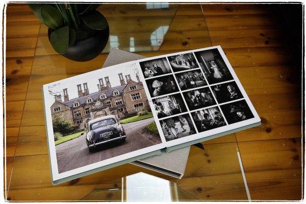 a fine art wedding album on a coffee table