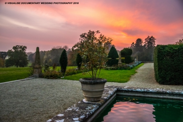 pink sunset in the gardens of eynsham hall