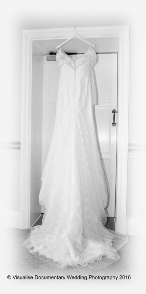 wedding dress hanging up in wedding venue