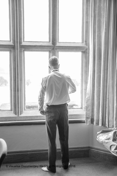 the groom peering out of a window