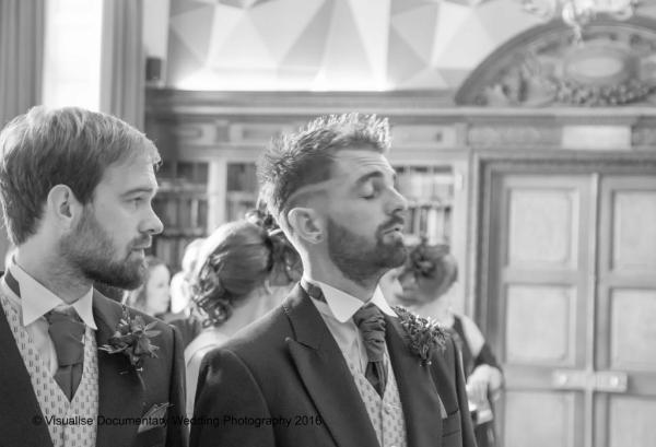 groom att eh altar looking nervous