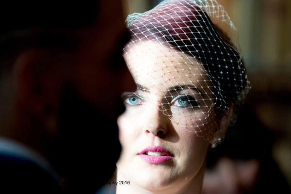 a bride looking into her grooms eyes at Eynsham Hall wedding