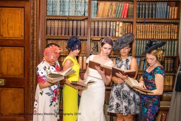 the bride and her friends reading books in a library