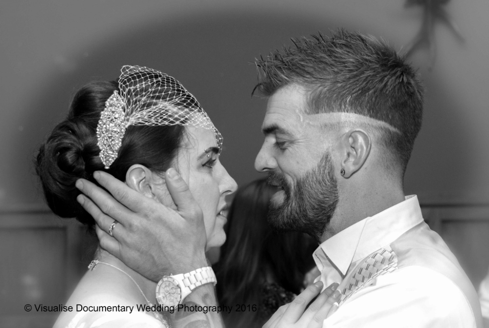 the groom holds his wifes face in hi hands, cotswold wedding photograph