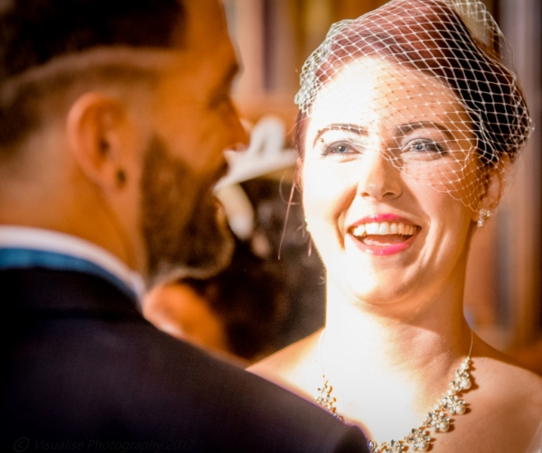 oxford wedding photographer, bride smiling at her groom