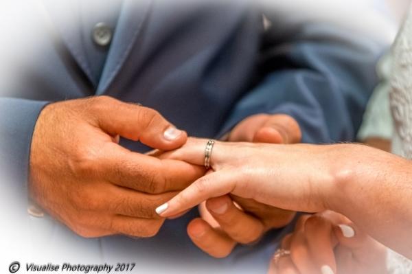 exchanging wedding rings, wedding photographer oxfordshire