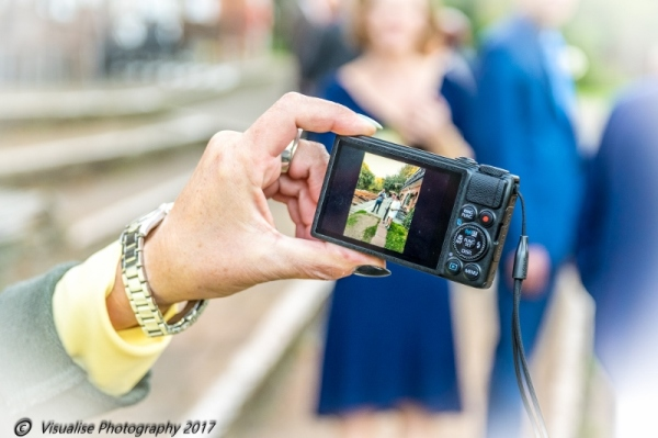 professional wedding photographer witney, looking at a camera screen