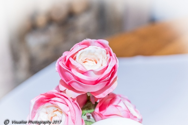 ROSE ON WEDDING CAKE AT THE BAYTREE HOTEL BURFORD WEDDING PHOTOGRAPHY OXFORDSHIRE