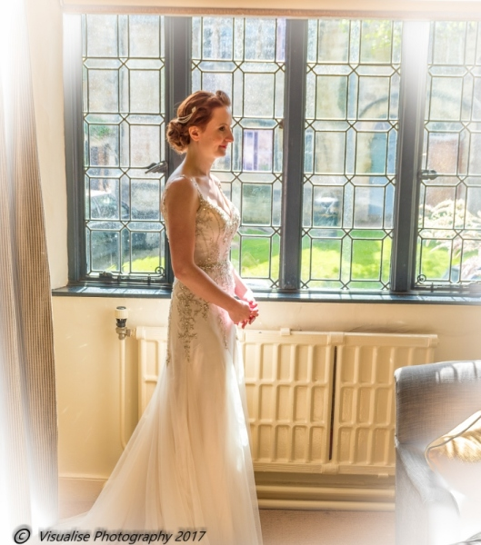 BRIDE WAITING TO LEAVE AT THE BAYTREE HOTEL BURFORD WEDDING PHOTOGRAPHY OXFORDSHIRE