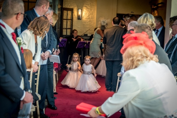 FLOWER GIRLS IN AISLE AT THE BAYTREE HOTEL BURFORD WEDDING PHOTOGRAPHY OXFORDSHIRE