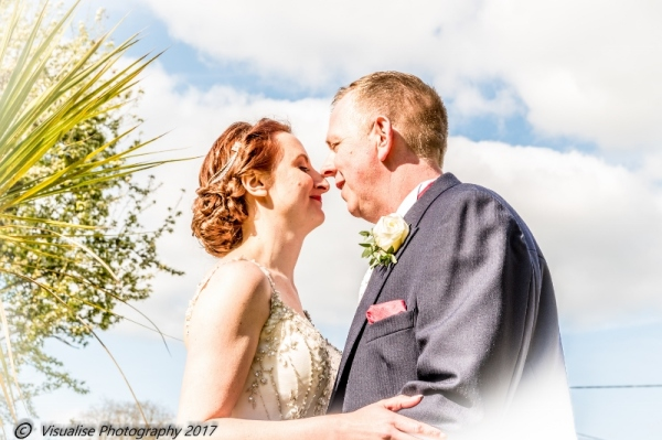 THE BRIDE AND GROOM SHARING A KISS AT THE BAYTREE HOTEL BURFORD