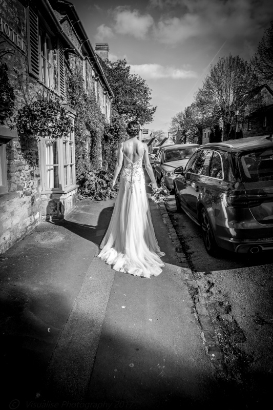 BRIDE WALKING DOWN BURFORD HIGH STREET