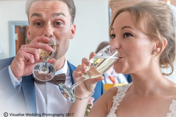 bride and groom sharing there first drink as a married couple