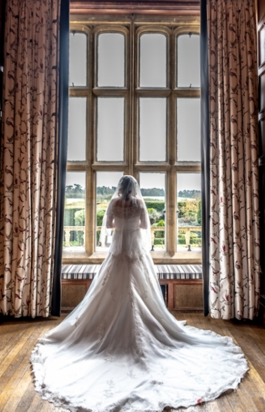 the bride looking at eynsham halls grounds