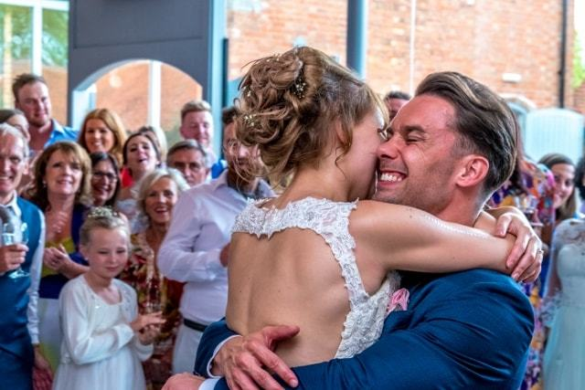 The bride and groom share the first dance with an embrace , Wedding Photographers in Oxfordshire  Carterton , Witney, Eynsham ,Oxford and oxfordshire , local wedding photography