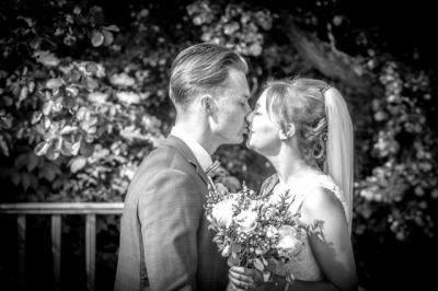 The bride and groom share a kiss during couple photos , Swallows Nest Barn Warwickshire Wedding Photographer