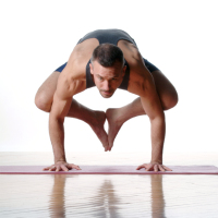 student in crow pose