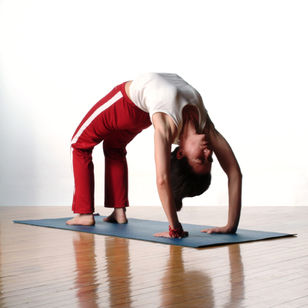 Student performing advanced yoga asana