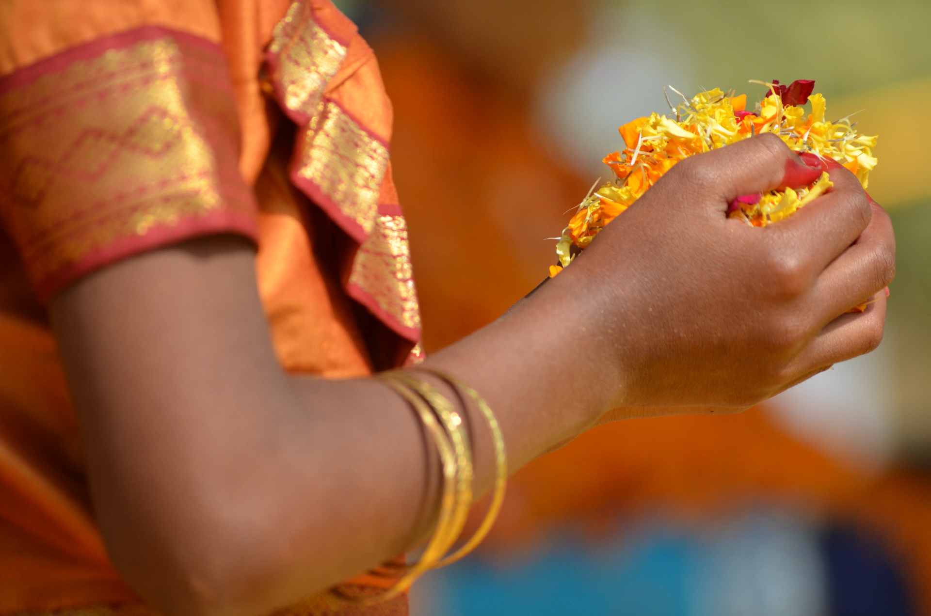 indian girl giving flowers