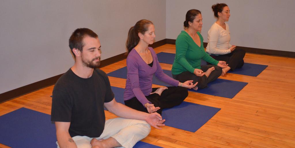 Satyananda Yoga lineage holder Swami Niranjan doing japa meditation with mala