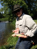 A happy American client with his first British brown trout