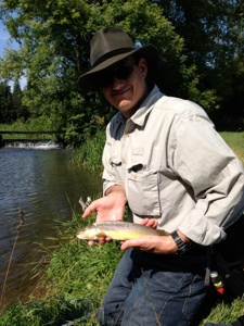 Andy Grey Fly Fishing client with his first Cotswold wild trout