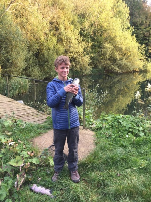 A young angler with a rainbow trout