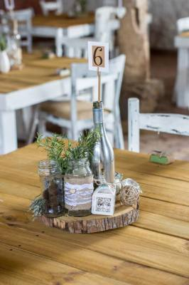 Rustic table centre pieces, cutt logs, rustic wedding