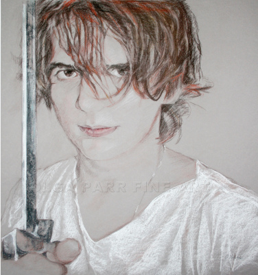 portrait of young boy with sword
