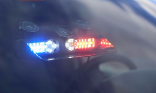 Police Cruiser with Red/Blue Dash and Deck Lighting in front windshield