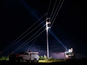 Golight shining light onto hydro pole from utility truck