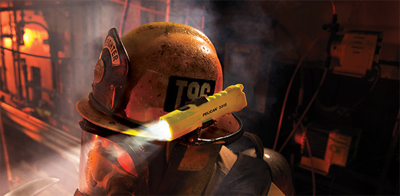 Firefighter with flashlight