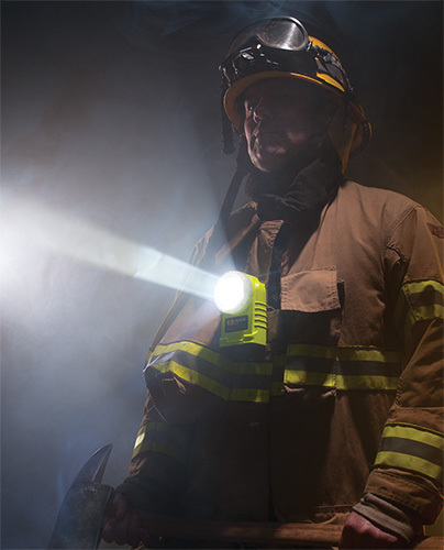 Firefighter with Pelican Right Angle Specialty Lighting