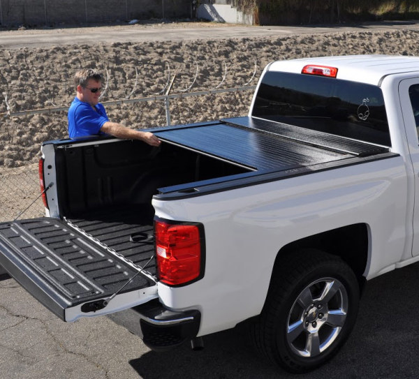 White pick-up truck with BAK BALFlip Fiber MaxFRP Fiberglass Truck Bed Cover