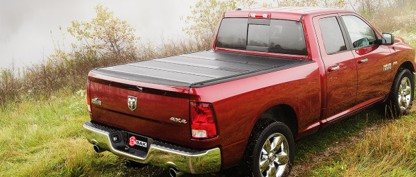 Red Pick-up truck with BAK BAKFlip F1 FRP Fiberglass Series Truck Bed Cover