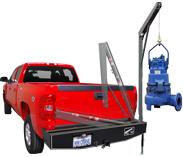 Western Mule fold-a-way crane on bumper of truck