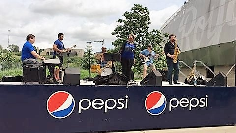 J Love Band performing at Kauffman Stadium
